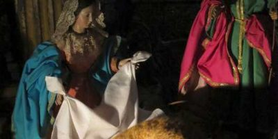 The nativity scene in Las Nieves church on Christmas Eve with a kitten in place of baby Jesus